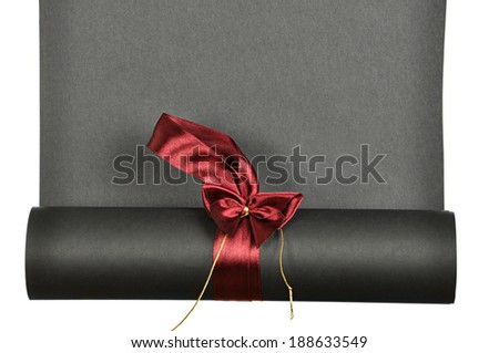 piece of black  paper rolled up in a roll isolated on white background