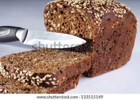 piece of bread, two slices and knife - stock photo