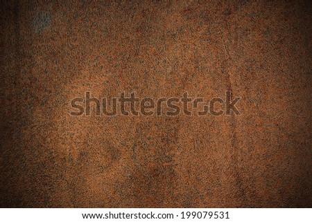 Piece of brown leather closeup for background or texture