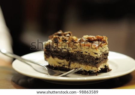 Piece of brownie on white plate - stock photo