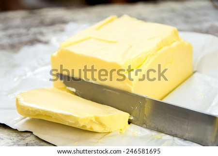 piece of butter on paper - stock photo