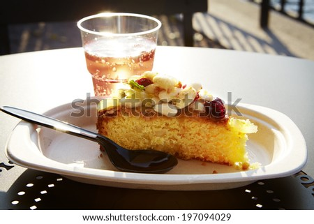 Piece of cake and drink - stock photo