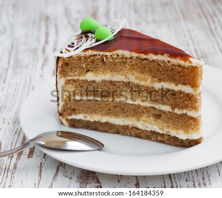 Piece of cake on a wooden background