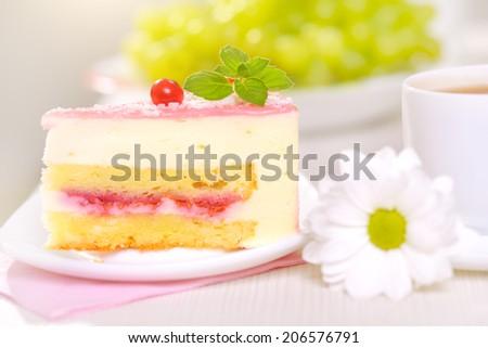 Piece of cake on light background - stock photo