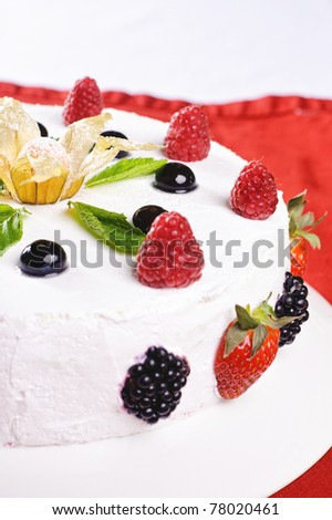 Piece of cake on plate with berries and fruits