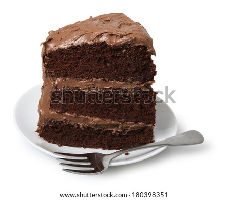Piece of cake on small dessert plate with fork, white background - stock photo