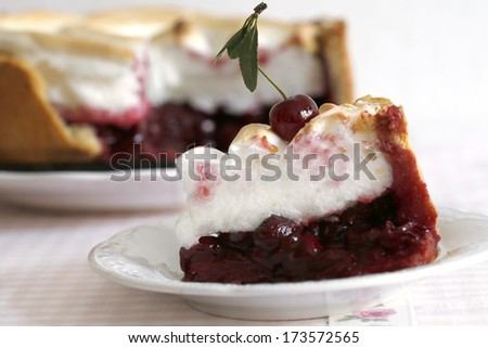 Piece of cake with cherries and meringue