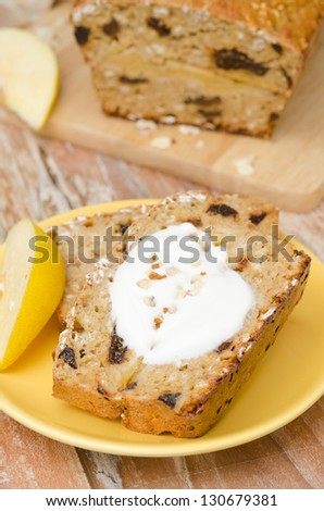 piece of cake with oatmeal, quince and prunes on a plate, closeup - stock photo