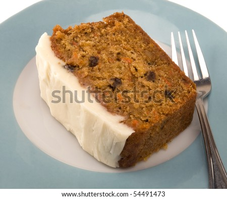 piece of carrot cake on turquoise plate - stock photo
