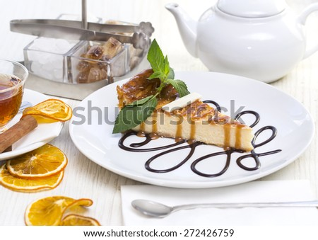 piece of cheese cake with caramel sauce - stock photo