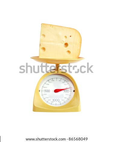 Piece of cheese lying on nice yellow kitchen scale. Isolated on white with clipping path - stock photo