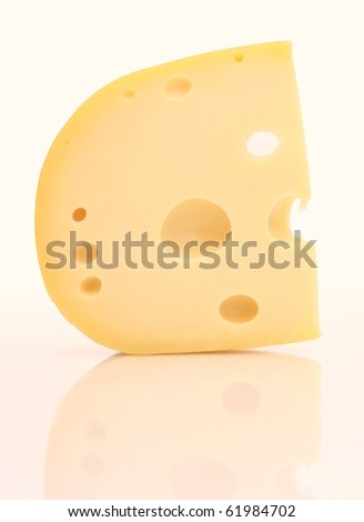 Piece of cheese with holes.
