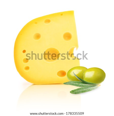 Piece of cheese with holes and green olives isolated on white background. - stock photo