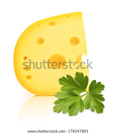 Piece of cheese with holes and parsley herb isolated on white background. - stock photo