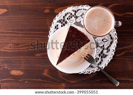piece of chocolate cake and cappuccinotop view - stock photo