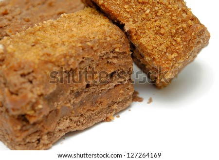 Piece of chocolate cake isolated on white  background