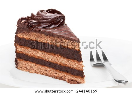 Piece of chocolate cake on white plate, isolated on the white background. - stock photo