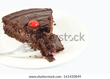 Piece of chocolate cake with cherry cream