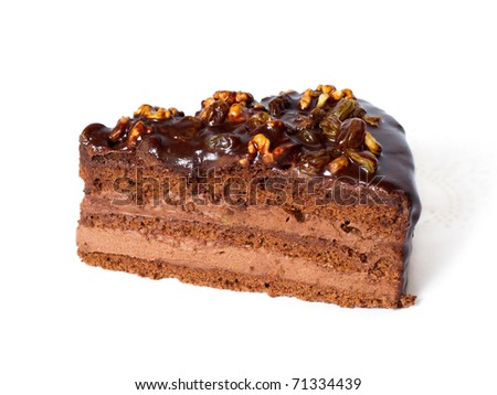 Piece of chocolate cake with walnuts. Isolated on white background. - stock photo