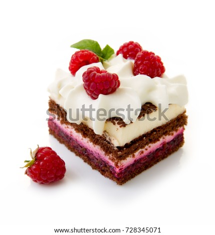 Piece of chocolate cake with whipped cream and raspberries isolated on a white background.