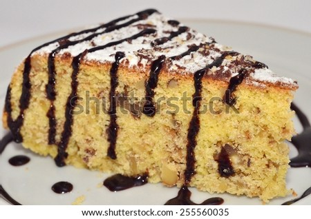 Piece of Corn Cake/ a piece of cake made of corn flour under chocolate icing