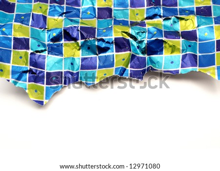 Piece of crumpled torn used wrapping paper over a white background - stock photo