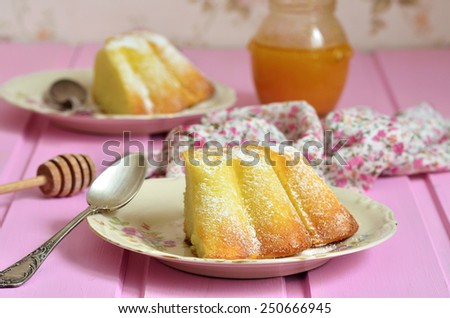 Piece of curd casserole (pudding) on a pink background. - stock photo