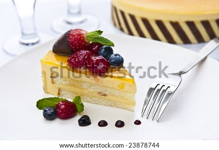 piece of delicious cake with a fork and glasses - stock photo