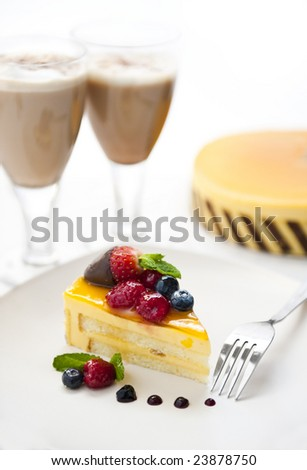 piece of delicious cake with latte - stock photo
