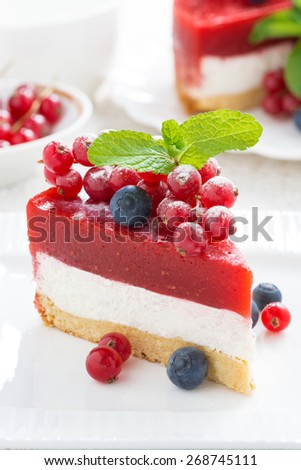 piece of delicious cheesecake with berry jelly on a plate, vertical, close-up - stock photo