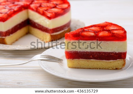 Piece of delicious cheesecake with strawberry mousse, strawberry jelly and strawberries. - stock photo