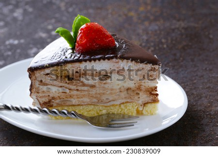 piece of delicious dessert festive cake with chocolate and fruits - stock photo