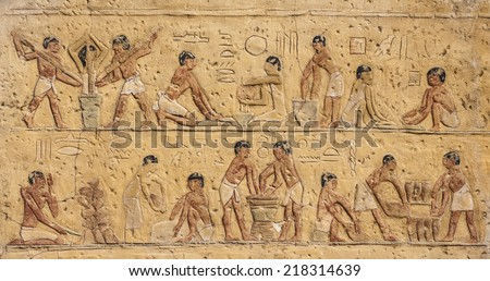 Piece of Egyptian decoration from a wall in Cairo, Egypt showcasing the daily tasks of the ancient people who used to live in the region. - stock photo