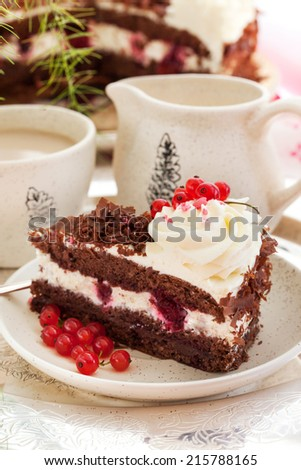 Piece of fresh homemade Black Forest cake with cherry and chocolate - stock photo