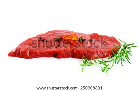 Piece of fresh raw meat with pepper, rosemary over white - stock photo