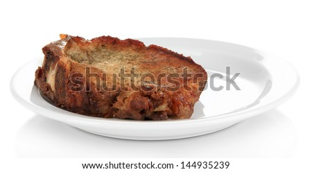 Piece of fried meat on plate isolated on white - stock photo