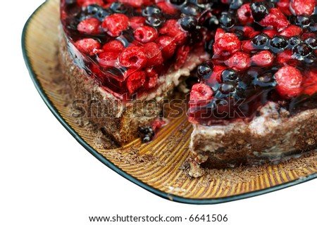 piece of fruit cake isolated on white - stock photo