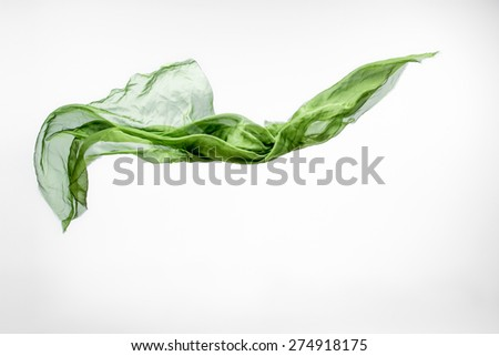 piece of green fabric flying, high speed studio shot, design element - stock photo