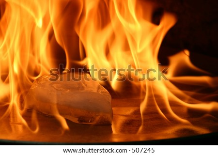 Piece of ice surrounded by flames