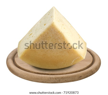 piece of italian cheese Montasio on a wooden plate