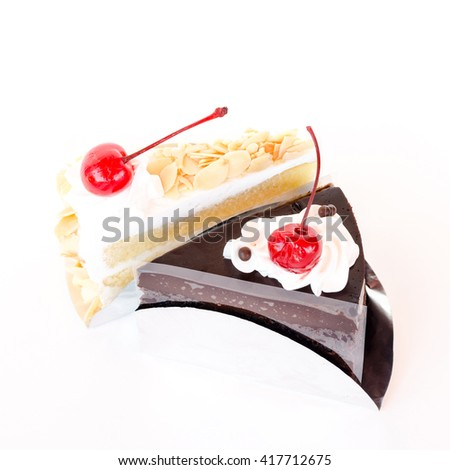 Piece of layer cake on white background - stock photo