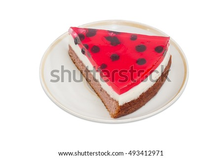 Piece of layered cake with layers of sponge cake, milk jelly and berry jelly on a saucer on a light background