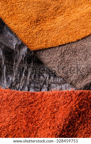 Piece of Leathers and Suede. Concept and Idea of Fine Leather Crafting, Handmade, Handcrafted Artisan, Leather and Fashion Industry. Background Textured and Wallpaper. - stock photo