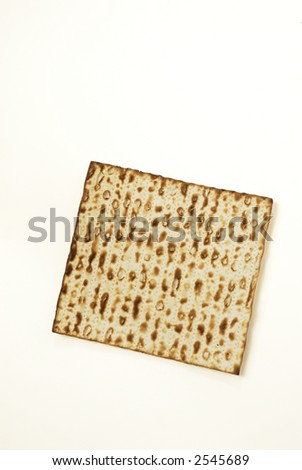 Piece of matzah on white background - stock photo