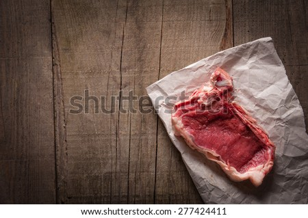 Piece of meat on paper - stock photo
