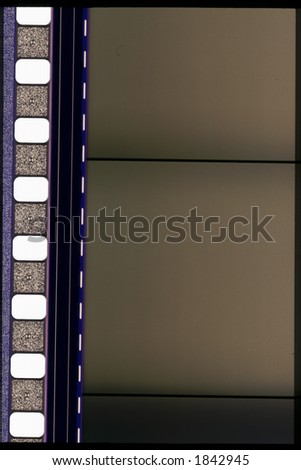 Piece of 35 mm motion or camera film - stock photo