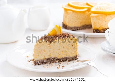 piece of orange cheesecake on a plate, horizontal - stock photo