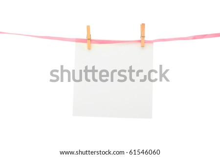 Piece of paper on pink line with space for text or picture