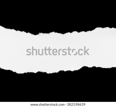 piece of ripped white paper on black background