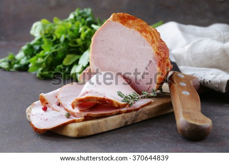 piece of roasted meat (ham) with pepper and thyme - stock photo